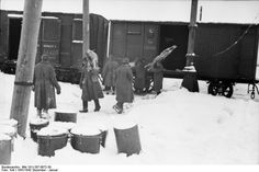 29th December 1941: A grim journey to the Russian front German troops unloading frozen supplies on the Eastern front during the winter of 1941-2
