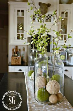 SPRING ISLAND JAR VIGNETTE- two big jars with burlap and moss balls at bottom #spring #kitch