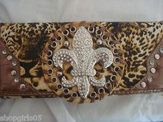 NEW! FLEUR DE LIS WALLET WOULD MAKE A GREAT GIFT. HAS PLACE FOR CHECKBOOK, ID, AND CREDIT CARDS. NICE!
