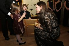 Catherine, Duchess of Cambridge talks with Jessica Geffen (L) and her brother Francis before a screening of David Attenborough's Natural History Museum Alive 3D at Natural History Museum on December 11, 2013 in London, England.