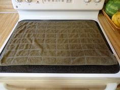 stove towel...how to clean a glass top stove with baking soda and a hot soapy towel.