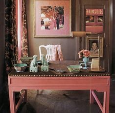 Mary McDonald says that she brazenly painted the Chinese desk hot pink and gave it a European style studded linen velvet upholstered top. The room also includes aqua Chinese garden stools and antique turquoise Chinese lamps, as well as lots of Chinese porcelain pieces and foo dogs on the desk. l love the pink and chocolate brown color combination with pops of blue.