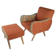 """Showcasing mango wood frames and a medallion motif, this eye-catching arm chair and ottoman set is a perfect addition to your living room or den.  Product: Chair and ottoman Construction Material: Mango wood and vintage gotton kantha fabric Color: Red, blue, cream and natural Features:  Spindle legs Curved arms Dimensions: Ottoman: 18"""" H x 23"""" W x 17""""  27"""" H x 28"""" W x 33"""" Due to the vintage nature of this product, some wear and tear is to be expected."""