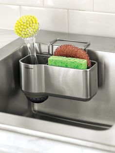 Tidy up the sink area with this stainless steel caddy. Tucked in this over-sink caddy, sponges and brushes stay handy without cluttering the countertop. And with plenty of drainage and air circulation, they stay fresher longer, too.