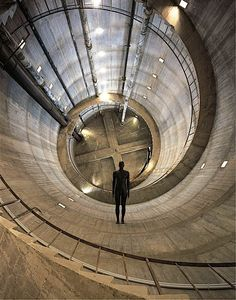 Anthony Gormley - 'Edge II', 2000  Cast iron, 38 x 54 x 193 cm  Installation view, TUSCIAELECTA: Arte Contemporanea Nel Chianti, San Casciano Water Tower, Italy, 2002/2003 Photograph by Rabatti & Domingie