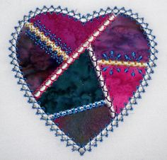 handmade heart Notice how additional stitches have been placed  ON TOP of the satin stitches