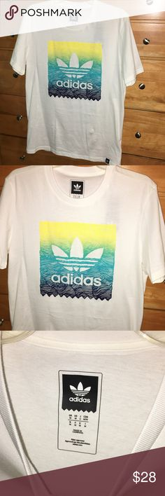 Adidas men's medium white tee green blue graphic Adidas - men's medium nwt. White tee with yellow, green, blue graphic block on front with adidas logo. Any questions - feel free to leave a comment below. Adidas Shirts Tees - Short Sleeve