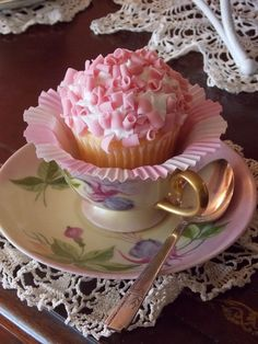A cupcake in a tea cup!  Now I love my tea even more.... need 2 cups though.  One for the tea and the other for a cupcake.