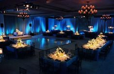 I. LOVE. This. Blue #uplighting and gold tables. #weddingreception