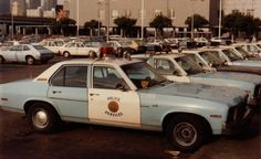 This came to an end in the early to mid 1980's when Oakland Chief George T. Hart returned the police cars to their black and white color scheme and restored the shield insignia to the doors.