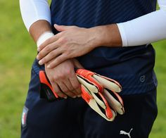 Gianluigi Donnarumma Photos Photos - Gianluigi Donnarumma of Italy (detail of hands) during a training session at the club's training ground at Coverciano on October 3, 2016 in Florence, Italy. - Italy Training Session And Press Conference