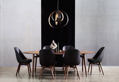 The Solo Oval dining table and chairs by NERI & HU with the Lunar pendant light by CTO LIGHTING and the