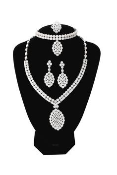 Moochi Platinum Plated White Zircon Embedded Hollow Flower Pedant Necklace Brass Jewelry Set. The jewelry set is made of hundreds of zircon stones, shinning and bling. Platinum Plated Brass Jewelry set with Zircon stone pendant. Shinning Luxury Jewelry for Celebrition, Costume, Party, Wedding, Show. Necklace Zircon size:42.5cm*10.2cm(16.7*4inch); Bracelet size: 20cm*4.1cm(8.0*1.6inch); Earring Zircon Pedant size:5.2cm*2.1cm(2.17*0.8inch);Ring Size: 2.4cm*2.5cm(1.0*1.0inch). This jewelry…