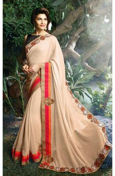 Give yourself an elegant look with this beige georgette saree. The pallu has a beautiful zari resham embroidered lace border. #Indian-fashion #sarees #online-shopping #shopping #fashions #women-fashions #buysareeonline