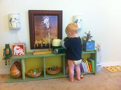 Montessori bedroom - toddler stuff is kept at the toddler level so the child can choose to play with anything he likes