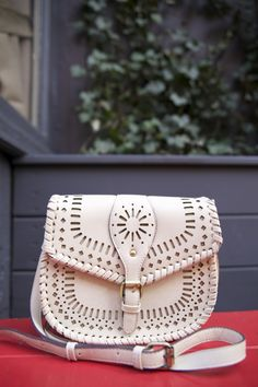 A great cross body bag to carry your essentials! Love the details!