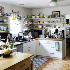 kitchen inspiration -- IKEA cabinets, open shelves with eclectic dishes, pot rack over sink/window