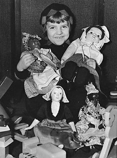 A promotional image for the US government's WPA Toy and Renovation Project showing a girl with dolls mended to be redistributed to impoverished children, United States, 1935, photographer unknown.