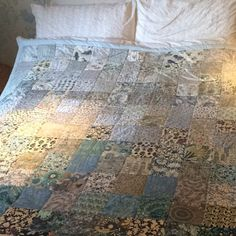 Homemade ombré patchwork quilt made from Liberty fabrics