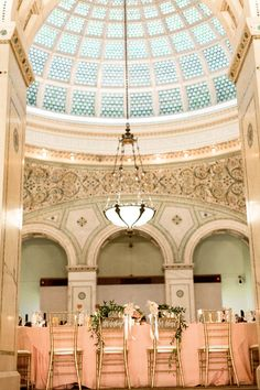 Chicago Cultural Center Wedding; flowers and greenery on bride and groom reception chairs