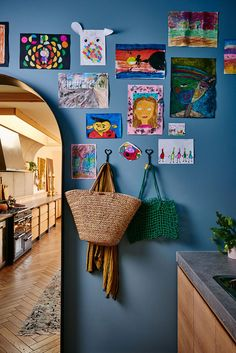 laundry room gallery wall with cute kids' art