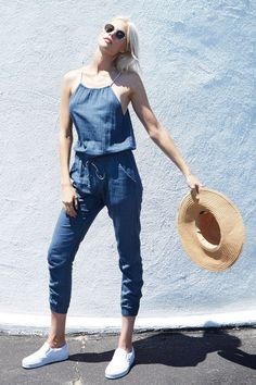 Woven jumpsuit cut in pinstriped indigo fabrication. Front trouser pockets and drawstring waistband. Keyhole detail at back. 25.75'' inseam (based on size 1). 100% cotton. Wash cold. Imported. Model i