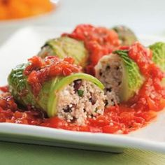 You can easily substitute Quinoa here: http://thebikinichef.com/couscous-cabbage-rolls/