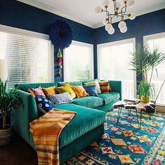 After waiting months for this amazing sectional sofa, designed by our absolute fav Justina Blakeney produced by Jonathan Louis is this to-die-for aqua green fabric and top stitched in halequin pattern) we finally get to feast our eyes on it! #Worththewait  The Jungalow by Justina Blakeney Photo: Dabito