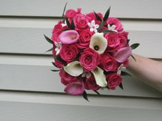 Pink wedding: For a pink, white, and black wedding a bouquet of roses, calla lilies, and stephanotis.  Leaves are painted black.  Designed by WhimsicalWelcomes.com Phila, PA