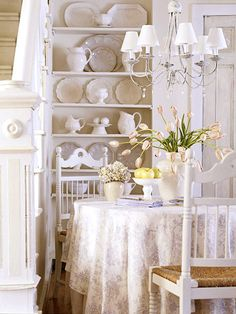 Bright and Airy- I love this dining area. I wouldn't mind having it in my dream home either. I love all the dishes on the built in shelves behind the table and the layers of table clothes. The chandelier is beautiful and the flowers are just perfect.