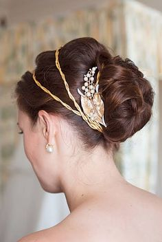 Wedding Hairstyle of the Week: A classic bun accented with vintage gold hair accessories