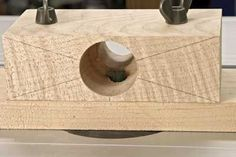 Wind the cutter up until the tip just lines up with the diameter of the outfeed hole