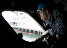 SAN DIEGO (April 3, 2013) Seaman Kameron Mack, assigned to the aircraft carrier USS Nimitz (CVN 68), looks for tugboats as the ship prepares to depart. Nimitz left San Diego for a Sustainment Training Exercise in preparation for an upcoming deployment. (U.S. Navy photo by Mass Communication Specialist 3rd Class Raul Moreno Jr./Released)