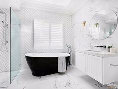 Black bath with herringbone subway tile