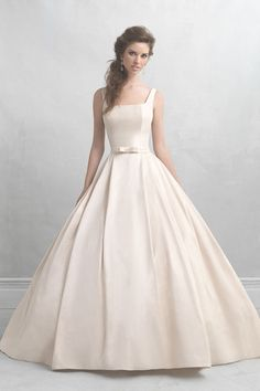 If there was ever a wedding dress that embodied sweetness, it's this classic cream satin ballgown! @allurebridals