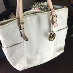 Beige AUTHENTIC Michael Kors Purse For Sale Selling my beige/cream colored Michael Kors purse. It has normal wear and tear. Hardware shows little to no signs of wear. Inside looks new other than a pen mark. Haven't used in years, it needs a new home! Will trade for a small Louis :) Michael Kors Bags Shoulder Bags