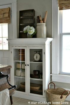 Add some crown molding to top of cabinet in dining room