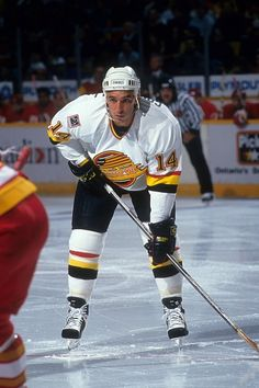 Geoff Courtnall of the Vancouver Canucks waits for the faceoff during an NHL preseason game against the Calgary Flames in September 1993 at the...