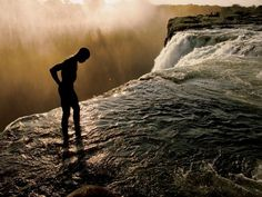 """Devils Pool Victoria Falls, Zambia - The Most Dangerous Pool In The World! """"Devil's Pool"""": the world's highest and most dangerous infinity pool. The world's highest and most daring infinity pool in the world is located on the edge of Victoria Falls. Livingstone, National Geographic, Chutes Victoria, Oh The Places You'll Go, Places To Visit, Hidden Pool, Earth Photos, Natural Swimming Pools, Beautiful Places"""