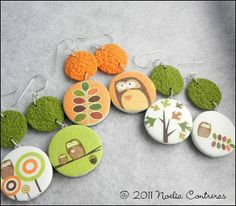 Earrings with transfers & texture by Daoine -- I like that the pairs are not matched