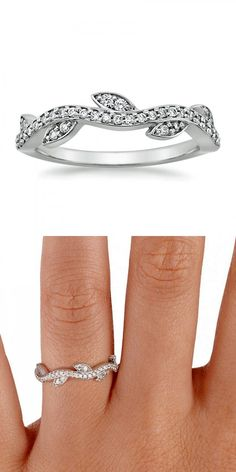 This beautiful band features fluid curves of shimmering pavé diamond accents and four marquise-shaped buds accented with pavé diamonds.
