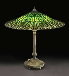 """A """"Lotus"""" leaded glass table lamp with a patinated bronze base, Tiffany Studios New York circa 1905."""