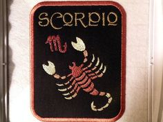 """All zodiac iron on patches measure 5.8"""" x 4.5"""" . The lettering is done in metallic gold, the zodiac icon is done in metallic copper, and the symbol"""