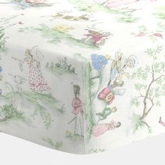 "Nursery Rhyme Toile Crib Sheet by Carousel Designs.  Our fitted crib sheets feature deep pockets and have elastic all the way around the edges to hug mattresses securely. Fits standard crib mattresses, measuring approximately 28"" x 52""."