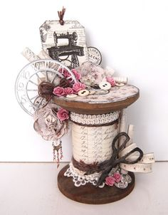 An altered wooden spool by Ingrid, featuring the Alma's Sewing Room collection