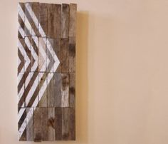I like this idea of painting a pattern on the reclaimed wood.