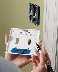 Tips and Tricks: Never again forget your room's paint color choice! On the inside of your light switch or outlet cover, using a permanent marker, just write the paint brand, color name, swatch number on a piece of painter's tape for quick reference. Wallpapering Tips, Do It Yourself Inspiration, Paint Brands, Room Paint Colors, Painters Tape, Do It Yourself Home, Light Switch Covers, Painting Tips, Painting Art