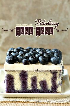 Blueberry Poke Cake - A moist blueberry lemon poke cake with a homemade white cake mix and blueberry syrup poured into poked holes in the cake. Topped with a lemon whipped cream frosting and fresh blueberries. This poke cake boasts a superior moistness, thanks to plenty of fresh blueberries made into the perfect syrup.