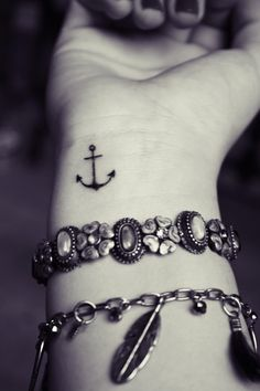 mini anchor tattoo on wrist with bracelets