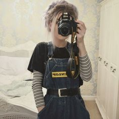 90s fashion vibes. T-shirt layered underneath overalls.